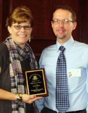 Dr. Lucia Unrau is awarded the Ohio Music Teachers Association Collegiate Teacher of the Year award by Dr. Michael Benson, Certification Chair of OhioMTA.