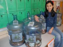 Third grader Annalise Nisly with the pennies collected so far
