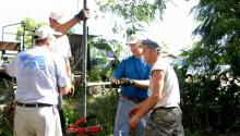 Bob Fett (on right) working on a well in Haiti