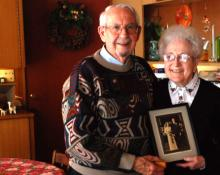 Luther and Geneva Shetler hold their wedding photo from 70 years ago