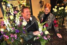 Doug Smith creates a floral arrangement with Renee Smith's assistance - click on image to enlarge