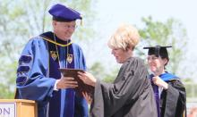 Bluffton University President James M. Harder presents Karel Oxley, superintendent of Lima City Schools, with an honorary doctorate of humane letters prior to her commencement address at Bluffton on May 6. Looking on is Dr. Sally Weaver Sommer, vice president and dean of academic affairs.