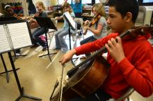 Sixth grade strings rehearse for Friday's event