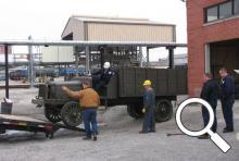 Unloading the Allen County Museum's 1918 Gramm Bernstein Liberty truck at the Lima Refinery restoration is underway.