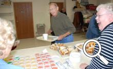 Wayne Matter has a good laugh as he fills his plate during the community dinner on Oct. 15.