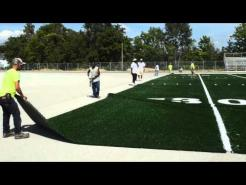 Rolling out turf, Bluffton University, 7 24 15